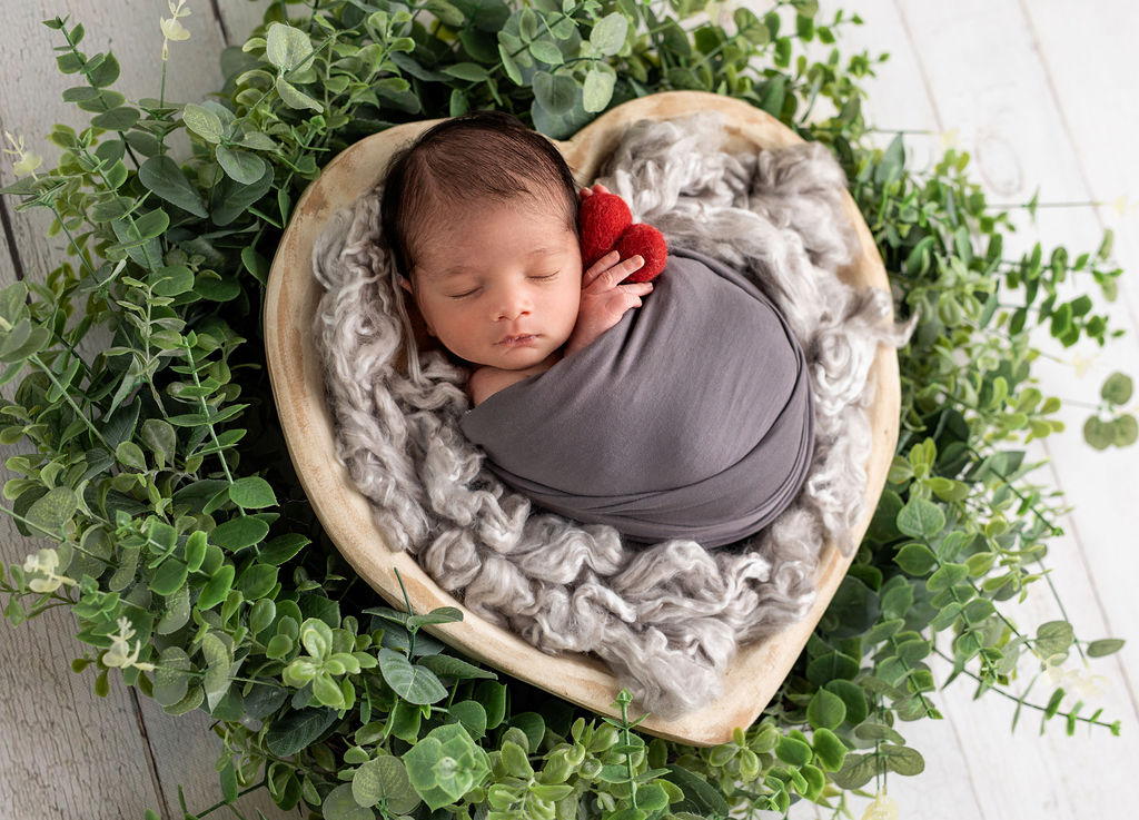 Very cute photo of the newborn baby during his photo session in home studio