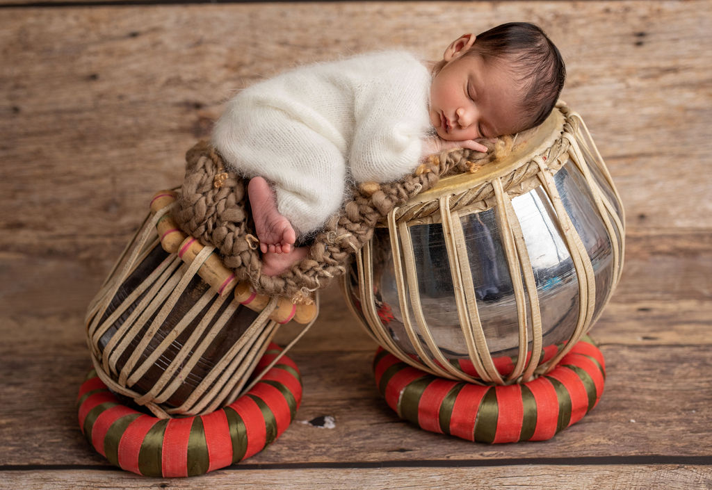 Newborn boy is photographed during the session in Chicago studio