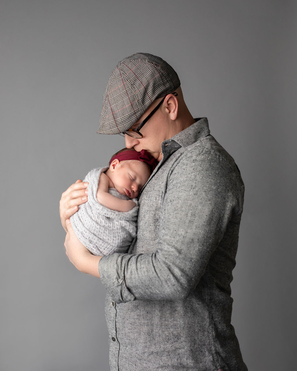 Father and the newborn in Chicago studio photo session